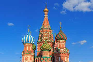 Domes of St. Basil's Cathedral on Red square in Moscow on a blue sky background in sunny summer evening