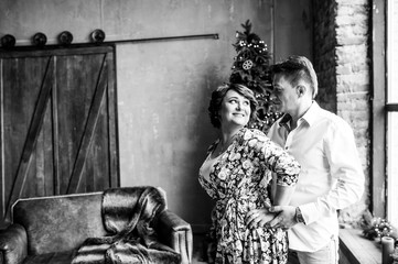 Beautiful parental couple in a New Year's interior