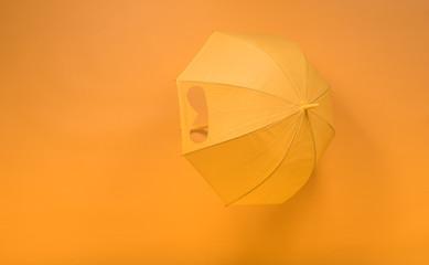 yellow umbrella on a yellow background