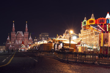 Moscow, Red square on Celebration Christmas and New Year. Festive decorations with shining lights in evening city, Russia. GUM and Kremlin on Xmas celebration.