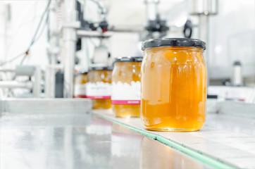 Gold organic honey in jar