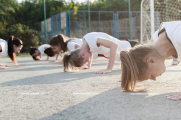 Group of young woman doing push-ups