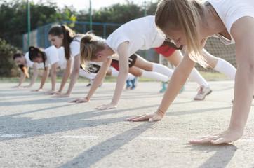 Female handball players doing push-ups