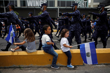 Salvadoran soldiers participate in a parade commemorating Independence Day in San Salvador