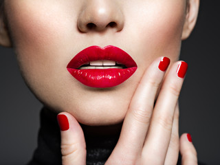 Closeup sexy female lips with red lipstick. Wall mural