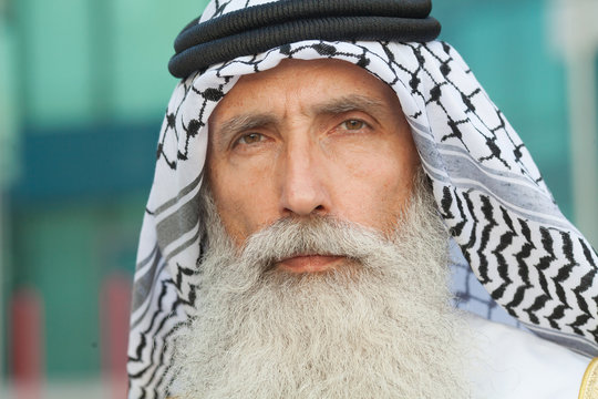 Senior Arabic man in traditional clothes outdoor portrait