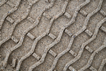 Tire tracks in the sand during construction