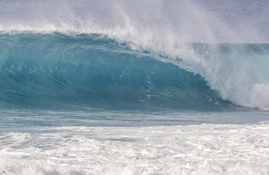 Beautiful light blue Ocean wave barrel breaking in Hawaii