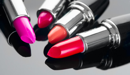 Lipstick. Professional makeup and beauty. Lipstick tints palette closeup. Colorful lipsticks over black background