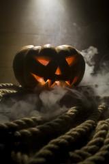Jack-o-lantern Halloween pumpkin head. Scary evil face spooky holiday. Halloween part. Halloween attributes.