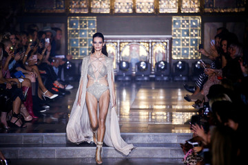 A models presents creations at the Julien Macdonald show at London Fashion Week Women's in London