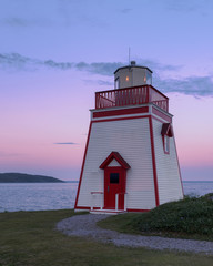 Fototapete - Fox Point Lighthouse at sunset in St. Anthony, Newfoundland