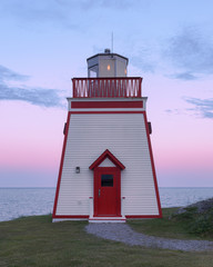 Wall Mural - Fox Point Lighthouse at sunset in St. Anthony, Newfoundland