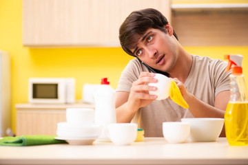Man washing dishes at home
