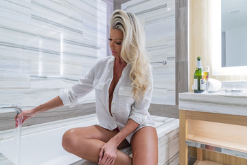 Lovely Blonde Model Preparing To Take A Bath