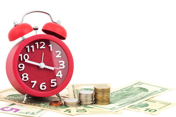 Red alarm clock and coins on money banknotes Euro and Dollars,concept of business planning and finance.