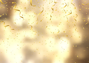 Gold confetti and streamers on defocussed background