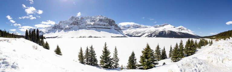 Panoramic View of Alpine Mountains over Frozen Lake