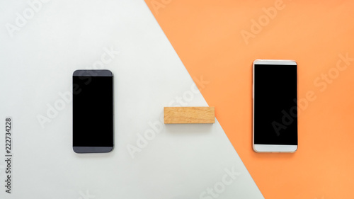 Wall mural Flat lay, top view office table desk. Workspace with smarth phone and wooden block on pastel background