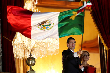 Mexico's President Pena Nieto waves the national flag as Mexico marks the 208th anniversary of its independence from Spain in Mexico City