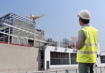 Drone inspection. Operator inspecting construction site control by civil engineer
