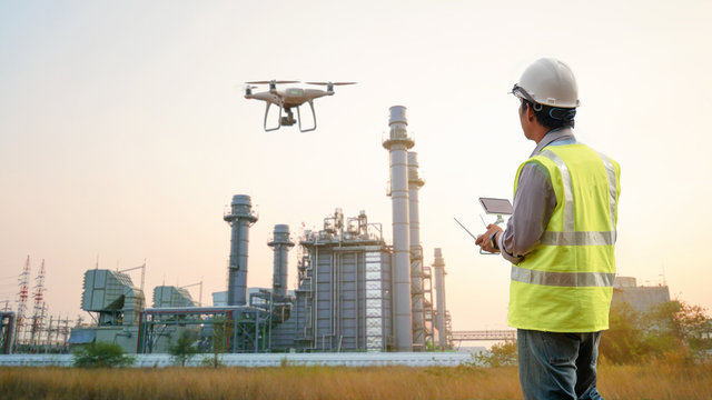 Drone inspection. Operator inspecting construction building  turbine power plant