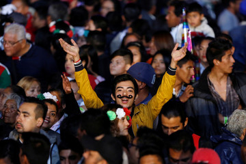 A young gestures while standing at Zocalo square, as Mexico marks the 208th anniversary of the independence from Spain, in Mexico City