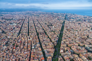 Barcelona aerial, wide angle view of the city skyline and urban grid, Spain
