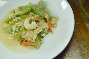stir fried angled gourd with egg topping shrimp on dish