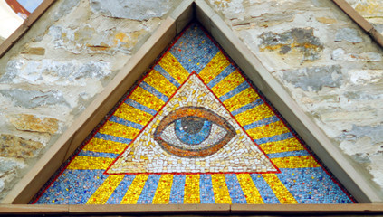 All-seeing eye of God - a mosaic of wall background medieval church