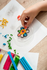 child play with plasticine. Colorful crafts. The concept of a happy childhood