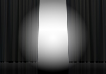 Open black curtain background and spotlight beam. Theatrical drapes