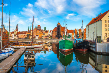 Aluminium Prints Historical buildings Gdansk old town and famous crane at amazing sunrise. Gdansk. Poland