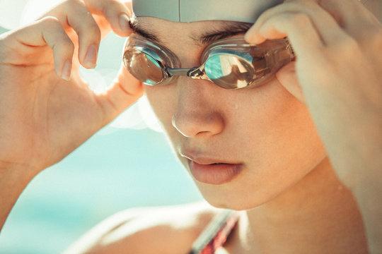 Woman adjusting swim goggles