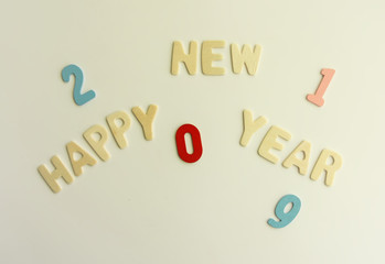 New Year decorative composition with wooden 2019 numbers and letters. Happy New Year festive card.