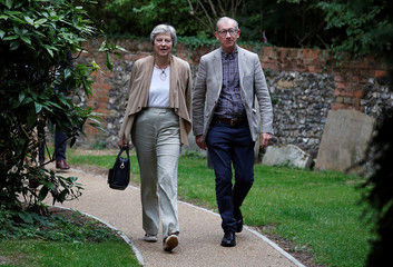 Britain's Prime Minister Theresa May and her husband Philip arrive at church, in Sonning, Britain