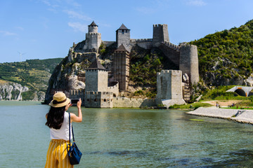 Tourist taking photo at Golubac fortress in Serbia