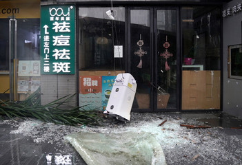 Broken glass is seen outside a restaurant after a rainstorm as Typhoon Mangkhut makes landfall in Guangdong province in Shenzhen
