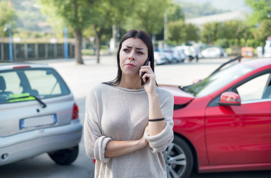 Woman calling towing service and roadside assistance