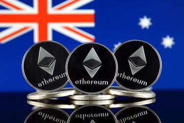 Physical version of Ethereum (ETH) and Australia Flag. Conceptual image for investors in cryptocurrency, Blockchain Technology, Smart Contracts, Personal Tokens and Initial Coin Offering.