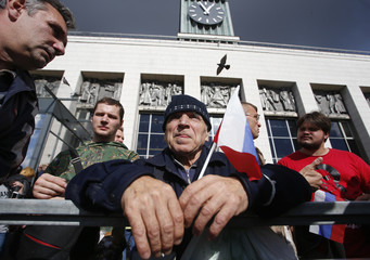 People take part in a rally against pension reforms in St. Petersburg