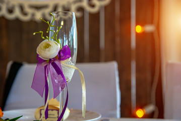 Festive glass with ribbon and flower
