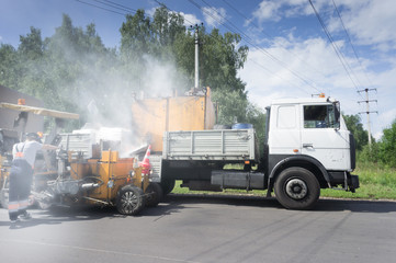 Road Construction. a lot of steam. application of road marking lines