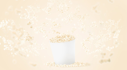Blank white food bucket with popcorn mockup on yellow background, depth of field effect, 3d rendering. Empty pail with falling pop corn mock up. Paper fastfood box template, isolated.