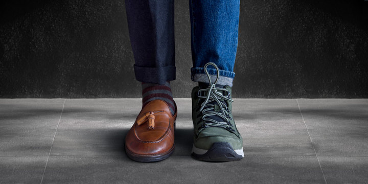 Work Life Balance Concept. Low Section of a Man Standing with Half of Working Shoes and Casual Traveling Shoes