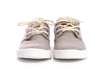 Close up of kids sneakers on white background