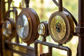 Closeup on a vintage dial meter with wood and copper