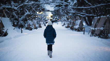 Asian girl walking in the park in the winter  night,Aomori Japan