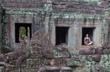 Girl looking at Angkor Wat temple in Cambodia