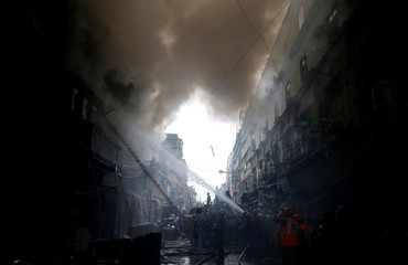 Firefighters try to douse a fire that broke out at a wholesale market in Kolkata